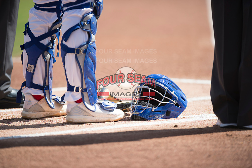 The mask of Stockton Ports catcher JJ Schwarz (29) rests during the playing of the National Anthem during a California League game against the San Jose Giants on April 9, 2019 in Stockton, California. San Jose defeated Stockton 4-3. (Zachary Lucy/Four Seam Images)