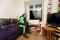 """Pictured: Adam Romain by the smashed window in the front room of his house in Waun-Wen Road in the Mayhill area of Swansea, Wales, UK. Thursday 20 May 2021<br /> Re: Gangs of """"yobs"""" have been setting fire to cars and rolling them down a hill in Swansea, Wales, UK.<br /> South Wales Police said they attended """"large scale disorder"""" in the Mayhill area of the city on Thursday evening."""