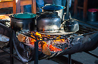 Chichicastenango, Guatemala.  Fire Heating Tea and Food in a Market Refreshment Stand.