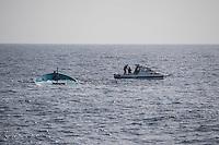 """Sea Watch-2.<br /> Die Sea Watch-2 bei ihrer 13. SAR-Mission vor der libyschen Kueste.<br /> Im Bild: Sogenannte """"Engine-Fisher"""" versuchen ein versenktes Holzboot abzuschleppen.<br /> 22.10.2016, Mediterranean Sea<br /> Copyright: Christian-Ditsch.de<br /> [Inhaltsveraendernde Manipulation des Fotos nur nach ausdruecklicher Genehmigung des Fotografen. Vereinbarungen ueber Abtretung von Persoenlichkeitsrechten/Model Release der abgebildeten Person/Personen liegen nicht vor. NO MODEL RELEASE! Nur fuer Redaktionelle Zwecke. Don't publish without copyright Christian-Ditsch.de, Veroeffentlichung nur mit Fotografennennung, sowie gegen Honorar, MwSt. und Beleg. Konto: I N G - D i B a, IBAN DE58500105175400192269, BIC INGDDEFFXXX, Kontakt: post@christian-ditsch.de<br /> Bei der Bearbeitung der Dateiinformationen darf die Urheberkennzeichnung in den EXIF- und  IPTC-Daten nicht entfernt werden, diese sind in digitalen Medien nach §95c UrhG rechtlich geschuetzt. Der Urhebervermerk wird gemaess §13 UrhG verlangt.]"""