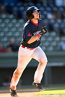 Catcher Kole Cottam (29) of the Greenville Drive runs out a batted ball in Game 1 of a doubleheader against the Rome Braves on Friday, August 3, 2018, at Fluor Field at the West End in Greenville, South Carolina. Rome won, 7-6. (Tom Priddy/Four Seam Images)