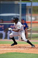GCL Marlins left fielder Milton Smith (4) follows through on a swing during a game against the GCL Mets on August 3, 2018 at St. Lucie Sports Complex in Port St. Lucie, Florida.  GCL Mets defeated GCL Marlins 3-2.  (Mike Janes/Four Seam Images)
