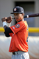 Shortstop Jeffry Santos (21) of the Greeneville Astros warms up before a game against the Bristol Pirates on Saturday, July 26, 2014, at DeVault Memorial Stadium in Bristol, Virginia. Greeneville won, 2-1 in Game 1 of a doubleheader. (Tom Priddy/Four Seam Images)