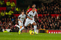 Saturday 11 January 2014 Pictured: Wayne Routledge runs forwards with the ball <br /> Re: Barclays Premier League Manchester Utd v Swansea City FC  at Old Trafford, Manchester