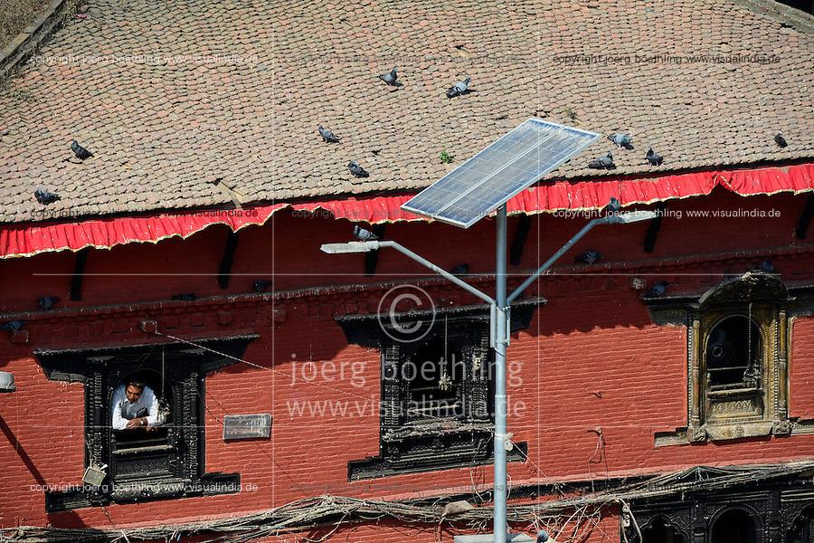 NEPAL Kathmandu, Durbar Square, historical building and solar street lantern / altes Gebaeude und Solar Strassenlaterne