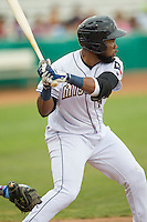San Antonio Missions outfielder Yeison Asencio (14) at bat during the Texas League baseball game against the Corpus Christi Hooks on May 10, 2015 at Nelson Wolff Stadium in San Antonio, Texas. The Missions defeated the Hooks 6-5. (Andrew Woolley/Four Seam Images)