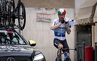 Giacomo Nizzolo (ITA/Qhubeka ASSOS) getting his rain jacket on while passing through the village of Borgo d'Ale<br /> <br /> 104th Giro d'Italia 2021 (2.UWT)<br /> Stage 3 from Biella to Canale (190km)<br /> <br /> ©kramon
