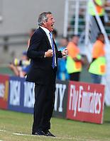 Uruguay coach Oscar Tabarez celebrates his sides winning goal by Diego Godin