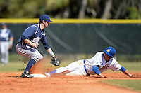 Georgetown Hoyas infielder Ryan Busch (1) attempts to tag Al Robbins (21) sliding in during a game against the South Dakota State JackRabbitsat South County Regional Park on March 9, 2014 in Port Charlotte, Florida.  Georgetown defeated South Dakota 7-4.  (Mike Janes/Four Seam Images)