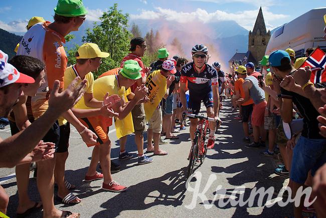 Martin Elmiger (SUI/IAM) seemingly enjoying the craziness at the Dutch Corner (nr7) up Alpe d'Huez<br /> <br /> stage 20: Modane Valfréjus - Alpe d'Huez (111km)<br /> 2015 Tour de France