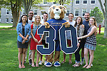 """Rhody with students and """"30"""" photographed on the Kingston Campus in South Kingstown, RI on Thursday, May 26, 2016.  (Photo/Joe Giblin)"""
