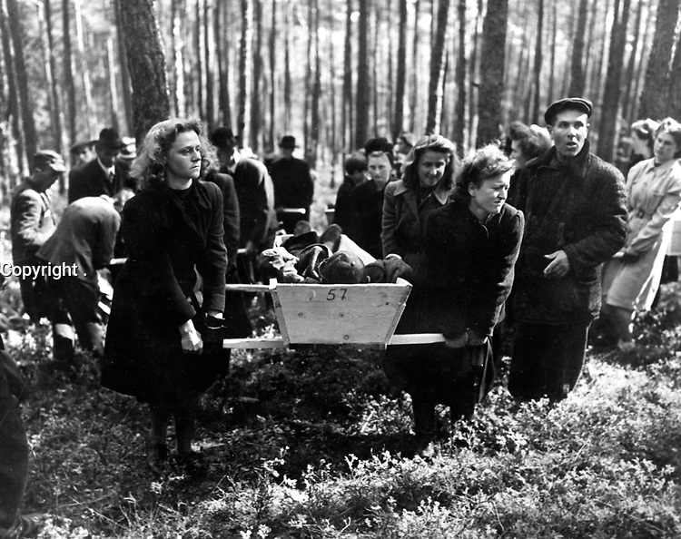 Civilians of Neunburg bear victims of SS killings to burial ground, after bodies were exhumed from mass grave where their murderers had dumped them.  Chaplains of U.S. Third Army will conduct burial services.  April 29, 1945.  Pfc. Wendell N. Hustead.  (Army)<br /> NARA FILE #:  111-SC-266656<br /> WAR & CONFLICT BOOK #:  1125
