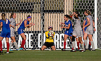 Alejandria Godinez (00) of DePaul cradles the ball after making a save in the last minute of the game at Shaw Field on the campus of Georgetown University in Washington, DC.  Georgetown tied DePaul, 1-1, in double overtime.