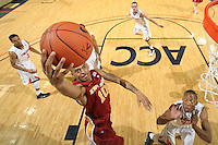 Dec. 30, 2010; Charlottesville, VA, USA; Iowa State Cyclones guard Diante Garrett (10) shoots over Virginia Cavaliers forward Akil Mitchell (25) during the game at the John Paul Jones Arena. Iowa State Cyclones won 60-47. Mandatory Credit: Andrew Shurtleff