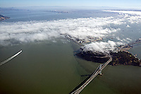 aerial photograph fog moves into San Francisco Bay towards Berkelely partially obscuring Treasure Island and Yerba Buena island San Francisco