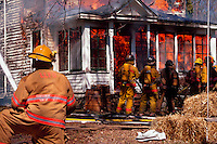 Firefighters practice house burn-down during training