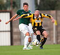 East Fife's Ross Campbell is caught from behind by Hib's Owain Tudor Jones.