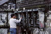 File Photo , New York , (NY) USA<br />A man use a telephone covered in graffiti in Manhattam, New York<br />(c) by Pierre Roussel / IMAGES DISTRIBUTION