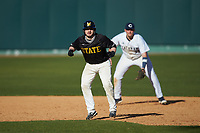 Austin Roe (21) of the West Virginia State Yellow Jackets takes his lead off of first base against the Catawba Indians at Newman Park on February 9, 2020 in Salisbury, North Carolina. The Indians defeated the Yellow Jackets 15-9 in game one of a doubleheader.  (Brian Westerholt/Four Seam Images)
