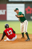 Second baseman Dallas Poulk #30 of the Greensboro Grasshoppers turns a double play against the Kannapolis Intimidators at Fieldcrest Cannon Stadium August 3, 2010, in Kannapolis, North Carolina.  Photo by Brian Westerholt / Four Seam Images
