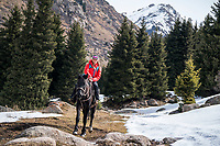 Riding horses into a backcountry yurt ski camp in the Aksuu Valley, Kyrgyzstan
