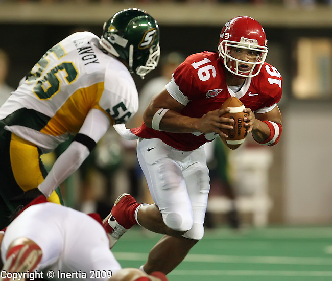 VERMILLION, SD - SEPTEMBER 26: Noah Shepard #16 of the University of South Dakota looks to get past the defense of Lindsey Leavoy #56 of Southeastern Louisiana in the second quarter of their game Saturday evening at the DakotaDome in Vermillion. (Photo by Dave Eggen/Inertia)