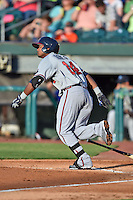 Mississippi Braves shortstop Elmer Reyes #14 swings at a pitch during the Southern League All Star game at AT&T Field on June 17, 2014 in Chattanooga, Tennessee. The Southern Division defeated the Northern Division 6-4. (Tony Farlow/Four Seam Images)