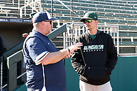 CARY, NC - FEBRUARY 23: Head coach Rob Cooper of Penn State University talks with head coach Jim Carone of Wagner College during a game between Wagner and Penn State at Coleman Field at USA Baseball National Training Complex on February 23, 2020 in Cary, North Carolina.