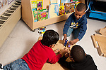 Education Preschool Headstart group of boys pretend play playing with human figures