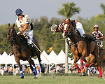 WELLINGTON, FL - FEBRUARY 05:  Joaquin Panela #2 of Valiente II and Lucas Criado #2 of Orchard Hill (dark blue) battle for the ball, during one of the early matches of the Ylvisaker Cup at the International Polo Club Palm Beach on February 05, 2017 in Wellington, Florida. (Photo by Liz Lamont/Eclipse Sportswire/Getty Images)