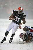 December 16th, 2007:  Cleveland Browns running back Jamal Lewis (31) avoids the reach of Buffalo Bills linebacker Angelo Crowell on a gain at Cleveland Browns Stadium in Cleveland, Ohio.  Lewis gained 164 yards during the Browns shutout of the Bills, 8-0, to inch close to clinching a playoff spot.  Photo copyright Mike Janes Photography 2007.