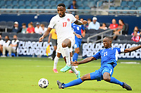 KANSASCITY, KS - JULY 11: Cyle Larin #17 of Canada goes past Sebastien Cretinoir #21 of Martinique during a game between Canada and Martinique at Children's Mercy Park on July 11, 2021 in KansasCity, Kansas.