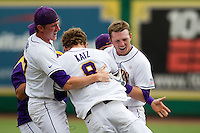 LSU Tigers outfielder Raph Rhymes #4 celebrates with teammate Mason Katz #8 following the conclusion their NCAA Super Regional baseball game against Stony Brook on June 9, 2012 at Alex Box Stadium in Baton Rouge, Louisiana. LSU defeated Stony Brook 5-4 in 12 innings. (Andrew Woolley/Four Seam Images).