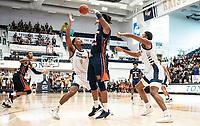 WASHINGTON, DC - NOVEMBER 16: Justin Williams #4 of George Washington defends against Mohamed Camara #14 of Morgan State during a game between Morgan State University and George Washington University at The Smith Center on November 16, 2019 in Washington, DC.