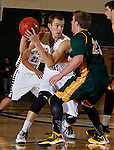 NOVEMBER 17, 2014 -- Jordan Dick #2 of South Dakota Mines looks past defender Tate Hilgenkamp#23 of Black Hills State during their college men's basketball game Monday evening at the Donald E. Young Center in Spearfish, S.D.  (Photo by Dick Carlson/Inertia)