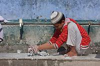 Madrasa Student Doing Laundry during Break between Classes, Madrasa Islamia Arabia Izharul-Uloom, Dehradun, India.