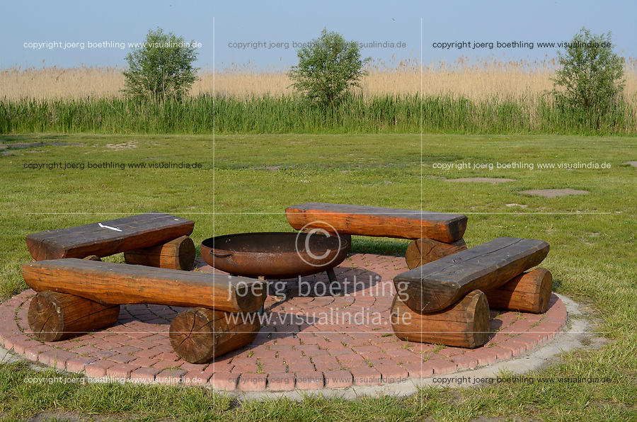 Germany, Darss, fireplace with timber bench