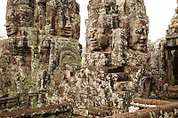 Over 200 identical smiling faces are carved into the towers of the Bayon temple ruins near Angkor Wat (Cambodia)
