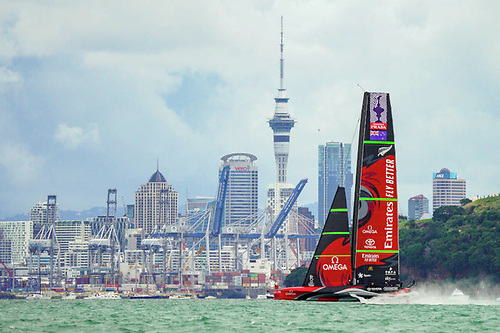 Emirates Team New Zealand against the Auckland city skyline in the 2021 America's Cup