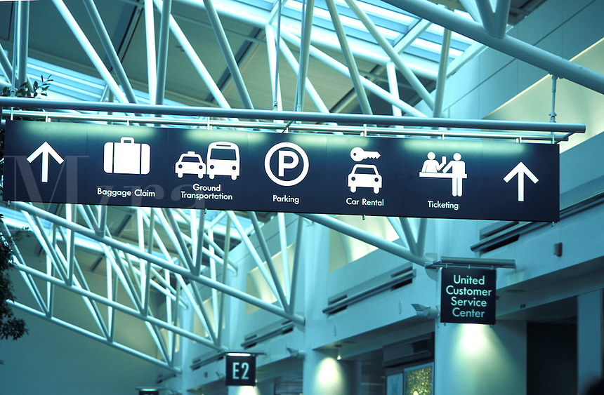 Directional sign board symbols at airport, Portland Oregon