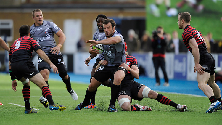 Bismarck du Plessis of Sharks is tackled by Mouritz Botha of Saracens during the Sanlam Private Investments Shield match between Saracens and the Cell C Sharks at Allianz Park on Saturday 25th January 2014 (Photo by Rob Munro)