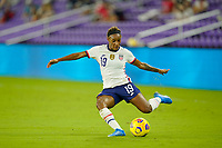 ORLANDO CITY, FL - FEBRUARY 18: Crystal Dunn #19 of the United States passes off the ball during a game between Canada and USWNT at Exploria Stadium on February 18, 2021 in Orlando City, Florida.