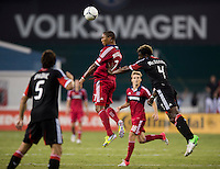 Brandon McDonald (4) of D.C. United goes up for a header with Sherjill McDonald (7) of the Chicago Fire at RFK Stadium in Washington, DC.  D.C. United defeated the Chicago Fire, 4-2.