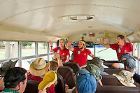 Photo story of Philmont Scout Ranch in Cimarron, New Mexico, taken during a Boy Scout Troop backpack trip in the summer of 2013. Photo is part of a comprehensive picture package which shows in-depth photography of a BSA Ventures crew on a trek. In this photo a BSA Venture Crews receive instructions from some very excited Philmont Rangers, as they ride a school bus to their drop off point for the start of their trek into the backcountry of the Philmont Scout Ranch. <br /> <br /> Photo by travel photograph: PatrickschneiderPhoto.com