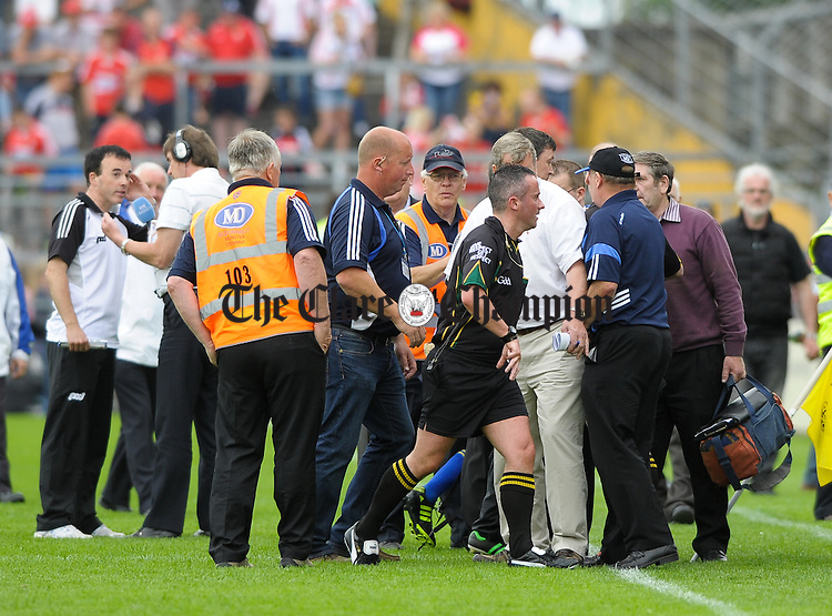 Referee Shane Mc Grath goes off at half time under the wrath of disgruntled Clare management team during the Senior hurling championship semi-final at Thurles. Photograph by John Kelly.