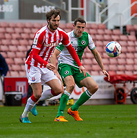 5th April 2021; Bet365 Stadium, Stoke, Staffordshire, England; English Football League Championship Football, Stoke City versus Millwall; Nick Powell of Stoke City under pressure from  Jed Wallace of Millwall