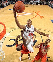 Feb. 2, 2011; Charlottesville, VA, USA; Virginia Cavaliers forward Akil Mitchell (25) shoots over Clemson Tigers forward Bryan Narcisse (21) and Clemson Tigers forward Milton Jennings (24) during the game at the John Paul Jones Arena. Mandatory Credit: Andrew Shurtleff