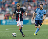 Foxborough, Massachusetts - October 15, 2017: First half action. In a Major League Soccer (MLS) match, New England Revolution (blue/white) vs New York City FC (light blue/blue), at Gillette Stadium.