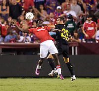 Mame Biram Diouf (32) of Manchester United goes up for a header with Armando Lozano (23) of Barcelona during the friendly at FedEX Field in Landover, MD.  Manchester United defeated FC Barcelona, 2-1.