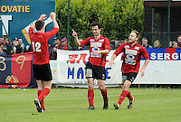 Izegem - FC Luik :....Tom Coghe (M) wordt gefeliciteerd door ploegmaats Arne Scheldeman (L) en Joachim Vercouter (R)..foto VDB / BART VANDENBROUCKE